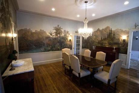 The formal dining room, for example, retains the 19th-century handpainted Zuber wallpaper displaying nature scenes from four climates.